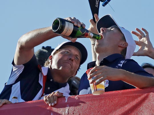 United States' Phil Mickelson pours Champagne on teammate United States' Jordan Spieth after the United States team won the Ryder Cup golf tournament Sunday, Oct. 2, 2016, at Hazeltine National Golf Club in Chaska, Minn.
