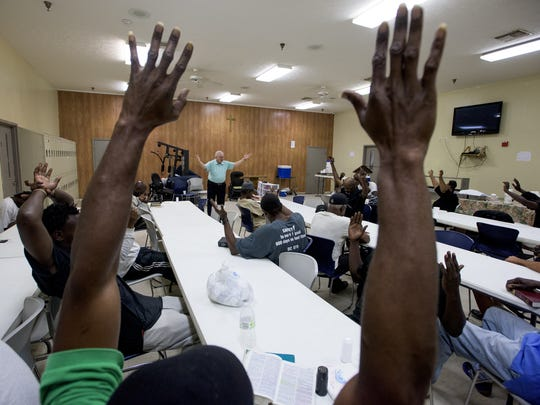 Pastor Rodney Tidwell, of Christ Vision Ministries, leads a church service at the Friendship Mission men's shelter in Montgomery, Ala., on Tuesday October 4, 2016.