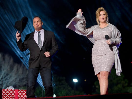 Country singers Garth Brooks and Tricia Yearwood perform at the National Christmas Tree Lighting attended by the first family on the Ellipse December 1, 2016 in Washington, DC.
