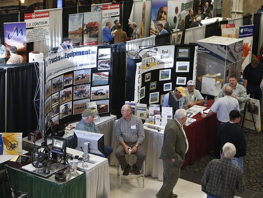 Exhibitors and attendees to the 2014 Montana Grain