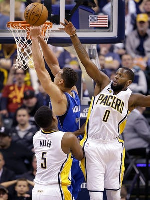 Indiana Pacers forward C.J. Miles (0) attempts to block the shot by Dallas Mavericks forward Dwight Powell (7) in the second half of their game Wednesday, Oct. 26, 2016,   at Bankers Life Fieldhouse.