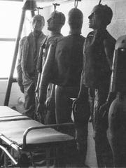 "This is a photo from the Air Force's ""The Roswell Report,"" released on June 24, 1997, about the UFO incident at Roswell, N.M., in 1947. Air Force personnel used stretchers and gurneys to pick up 200-pound dummies in the field and moved them to the laboratory. The 231-page report, released on the eve of the 50th anniversary of the Roswell, N.M., UFO incident, is meant to close the book on longstanding rumors that the Air Force recovered a flying saucer and extraterrestrial bodies near Roswell."
