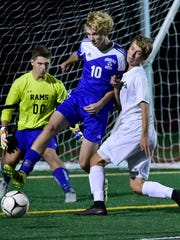 Kennard-Dale's Jacob Ingoe and James Lippiard (10) guard the goal from Greencastle's Brandon Stuhler (4). Greencastle battled Kennard-Dale in a PIAA District 3 Class 4A playoff soccer match on Monday, Oct. 23, 2017 at Kaley Field. The Blue Devils beat the Rams 4-0.