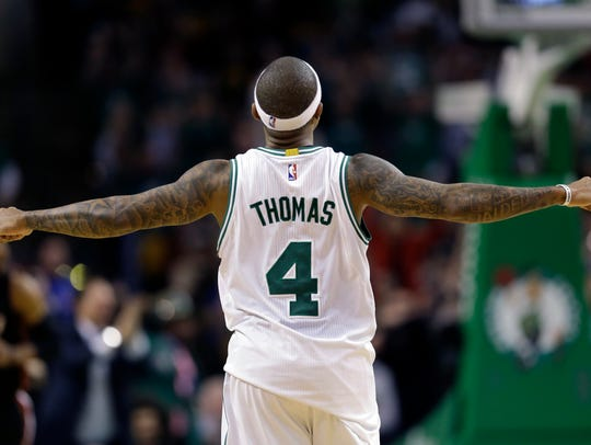 Boston Celtics guard Isaiah Thomas (4) celebrates in