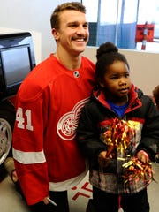 Luke Glendening poses for a photo with Shy'Quan Stafford.