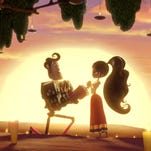 """Manolo, voiced by Diego Luna, left, and Maria, voiced by Zoe Saldana, in """"The Book of Life."""""""
