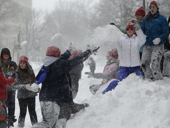A group of kids from Wisconsin play in the snow on