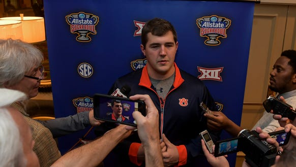Auburn left guard Alex Kozan speaks to the media on