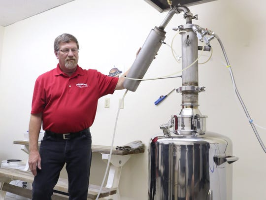 Richard Eggers of Legendary Rye shows a 26 gallon still