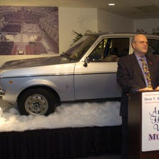 Dean Kruse, of Kruse International speaks at a new conference in Auburn, Ind., Thursday, May 18, 2005. The car that once was Pope John Paul II's personal vehicle went on display at Kruse Automotive and Carriage museum, Friday, May 20, 2005. The 1975 Ford Escort GL will be on display through May 30. (AP Photo/The Journal Gazette, Dean Musser Jr.)