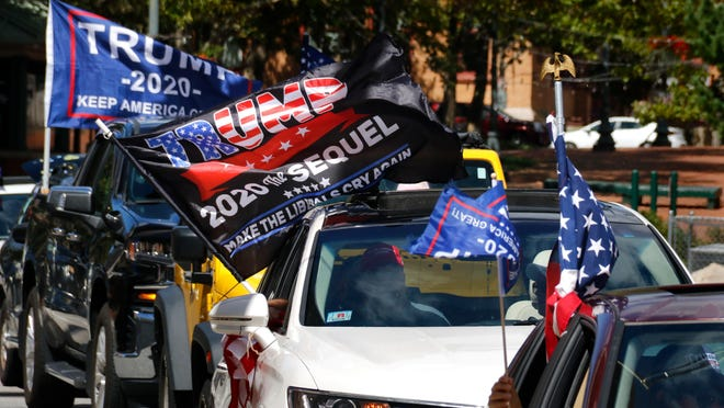 President Trump supporters roll through downtown Providence on Sunday.