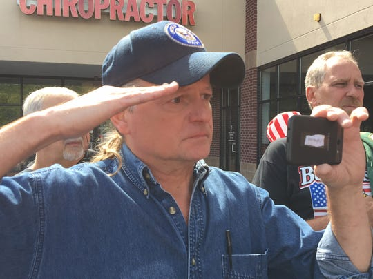"U.S. Navy veteran A.J. Piening of Blue Ash, Ohio, choked back tears as the national anthem was sung at a Wilder, Kentucky bar. Piening burned a Bengals hat and jersey to counterprotest NFL players kneeling during the national anthem to protest racial inequality. ""You just don't disrespect the flag,"" Piening said. ""I'm not going to watch the NFL anymore."" Piening said social media and other avenues are available to protest bad cops and racial injustice. ""A lot of people died for that flag,"" Piening said."