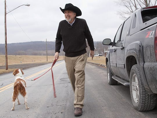 Elmira physician, Ed Foster, with his dog Fudge. Dr.