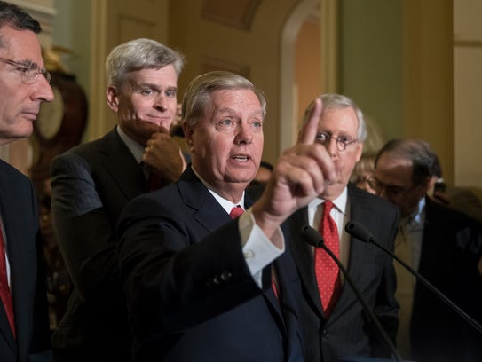 Sen. Lindsey Graham, joined by Sens. John Barrasso,