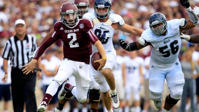 Texas A&M Aggies quarterback Johnny Manziel (2) rushes against the Rice Owls during the third quarter at Kyle Field.