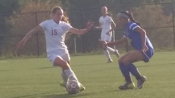 Somers junior defender Mary Murphy attempts to dribble