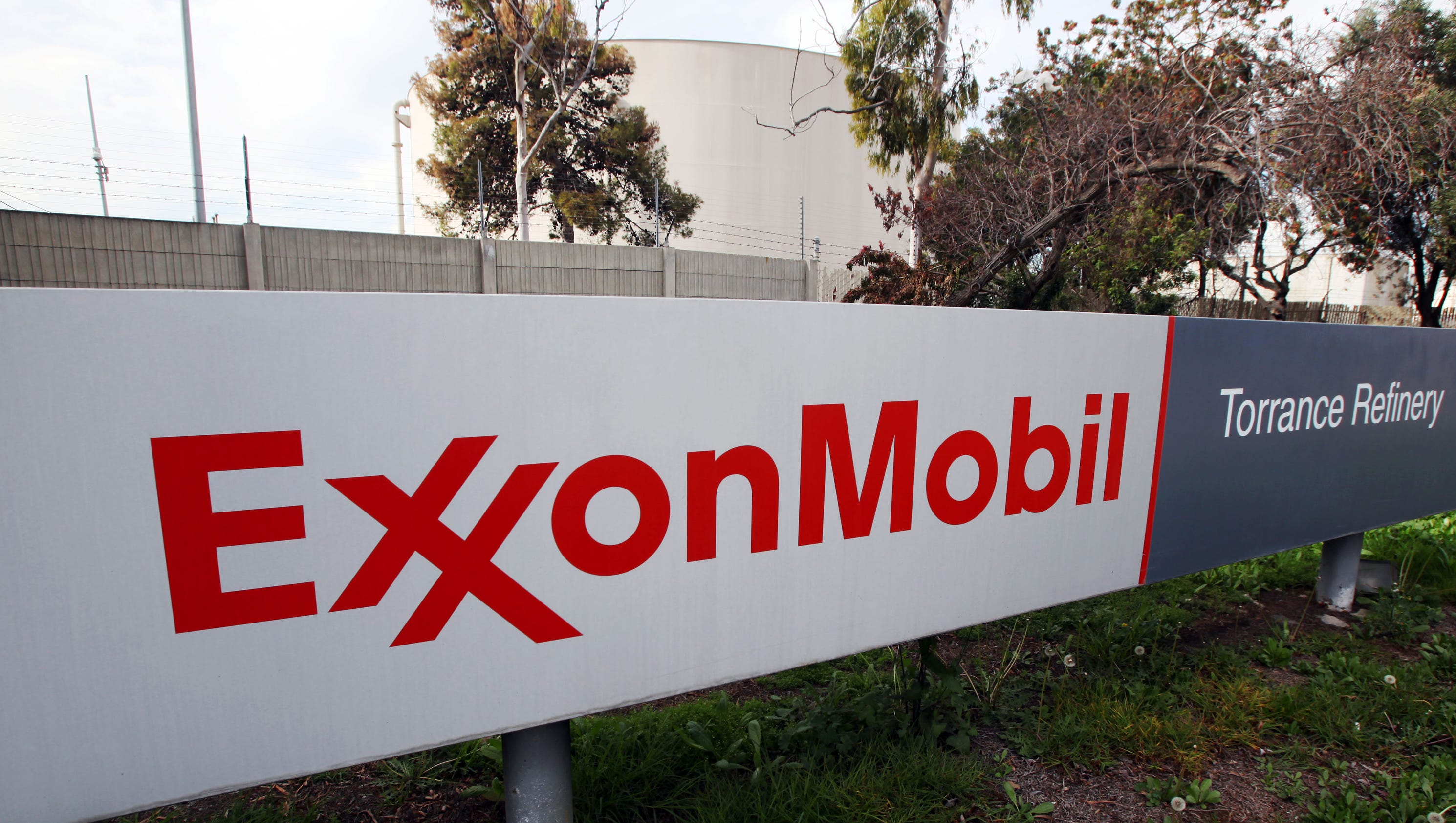 exxon mobil earnings up despite $2b charge