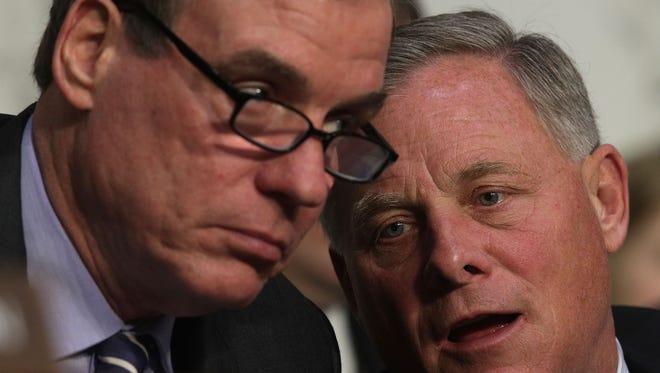 Senate Intelligence Committee Chairman Richard Burr, R-N.C, right, talks to Vice Chairman Mark Warner, D-VA,