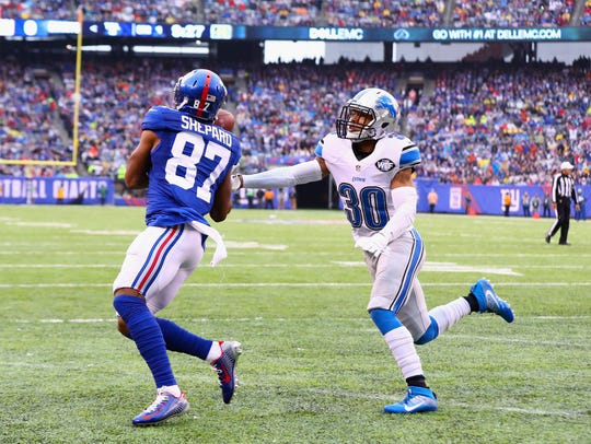 Giants receiver Sterling Shepard catches a touchdown pass in one of the neutral end zones at MetLife Stadium touchdown against the Detroit Lions in the first quarter on Dec. 18, 2016, in East Rutherford, New Jersey.