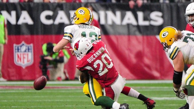 Dec 27, 2015: Arizona Cardinals strong safety Deone Bucannon (20) sacks and strips the ball from Green Bay Packers quarterback Aaron Rodgers (12) during the second half at University of Phoenix Stadium.