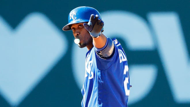 Kansas City Royals shortstop Alcides Escobar (2) celebrates his two-run single against the Boston Red Sox during the eighth inning at Fenway Park.