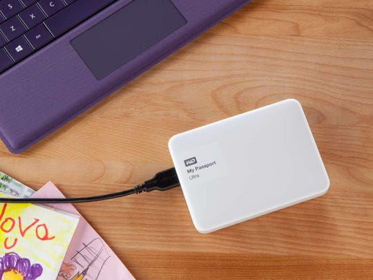 An external hard drive, such as this model by WD, lets you back up your important files on a regular basis.