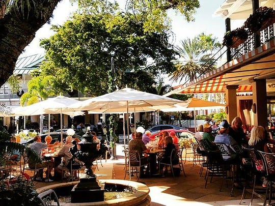 Open-air dining by Campiello's courtyard fountain on Third Street South in downtown Naples.