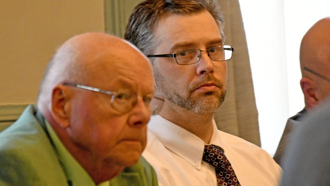 Shawn Grate and his attorney Robert Whitney listen to testimony on May 1 during Grate's murder trial in Ashland County Common Pleas Court.