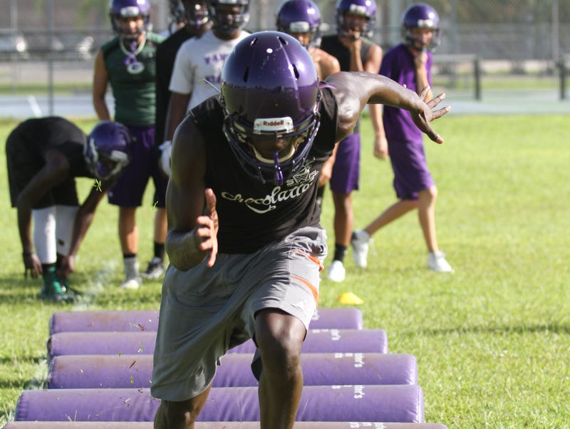 Cypress Lake High School had its first varsity football practice of the upcoming school-year Monday morning (8/1/16). Players began warm-ups and drills under first year football coach Richie Rode.
