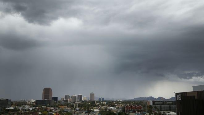 Rain moves over the city on Friday, May 15, 2015 in Phoenix, AZ.