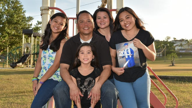 The Perez family take a group photo together at Gov. Joseph Flores Beach Park in Tumon on Feb. 15. Top from left: Nia, Boo, Nona, KK. Bottom from left: Kaydence, Nic Pangelinan (not present).