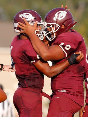 Okemos' Drew McGaughy, left, and Brock Jordan celebrate McGaughy's touchdown against Mason Thursday, Aug. 24, 2017, in Okemos, Mich.