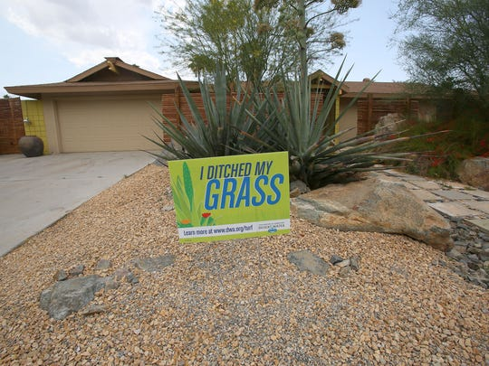 A sign at a home on Sonora Drive in Palm Springs shows where a lawn has been replaced with desert landscaping. The Desert Water Agency has provided cash incentives to promote the removal of turf.