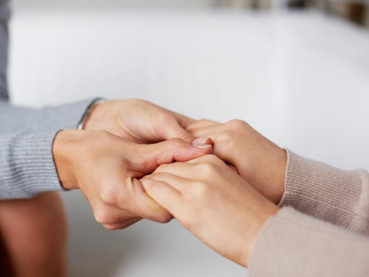 holding hands stock