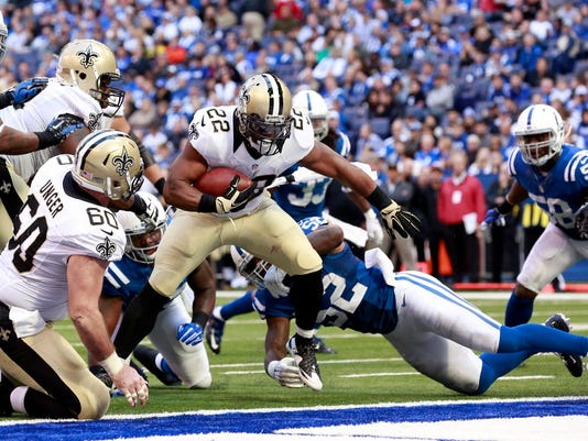 New Orleans Saints running back Mark Ingram (22) runs in for a touchdown against the Indianapolis Colts in the second half of an NFL football game in Indianapolis, Sunday, Oct. 25, 2015. (AP Photo/R Brent Smith)
