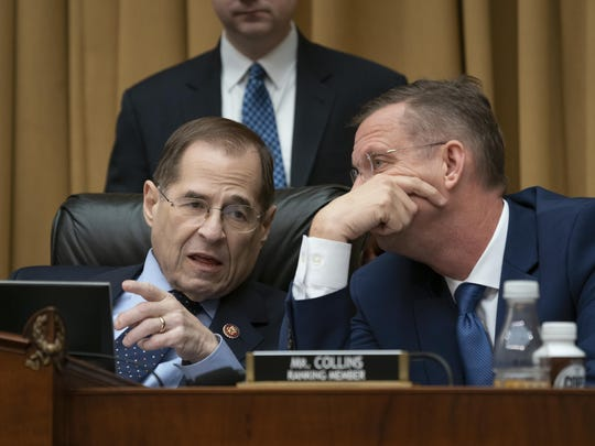 File photo from Friday, Feb. 8, 2019, House Judiciary Committee Chairman Jerrold Nadler, D-N.Y., left, and Rep. Doug Collins, R-Georgia, right, the top Republican, confer during a hearing on Capitol Hill in Washington. Nadler says that he believes President Donald Trump obstructed justice and that House Democrats are requesting documents from scores of people from Trump's administration, family and business as part of the Russia probe. Nadler says the House Judiciary Committee on Monday is requesting documents from the Justice Department, Donald Trump Jr. and Trump Organization executive Alan Weisselberg. (AP Photo/J. Scott Applewhite, file)