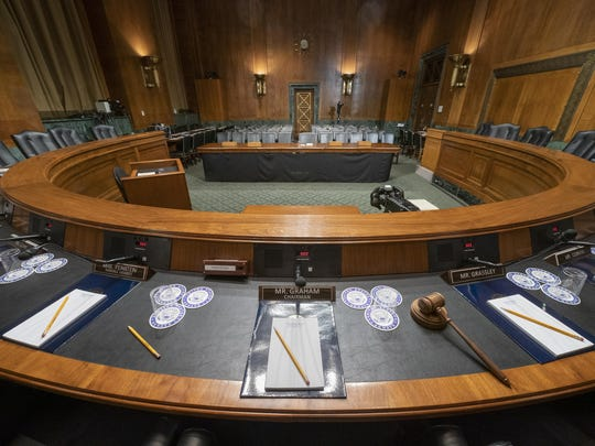 The Senate Judiciary Committee hearing room is prepared for Attorney General William Barr who will face lawmakers' questions Wednesday for the first time since releasing special counsel Robert Mueller's Russia report, on Capitol Hill in Washington, Tuesday, April 30, 2019.