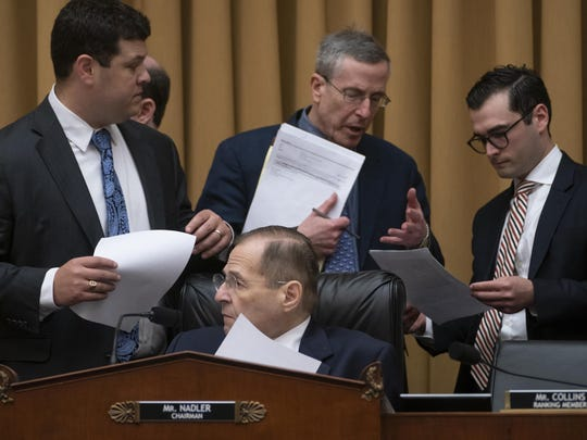 House Judiciary Committee Chair Jerrold Nadler, D-N.Y., is surrounded by committee staffers as he moves ahead with a vote to hold Attorney General William Barr in contempt of Congress after last-minute negotiations stalled with the Justice Department over access to the full, unredacted version of special counsel Robert Mueller's report, on Capitol Hill in Washington, Wednesday, May 8, 2019. (AP Photo/J. Scott Applewhite)