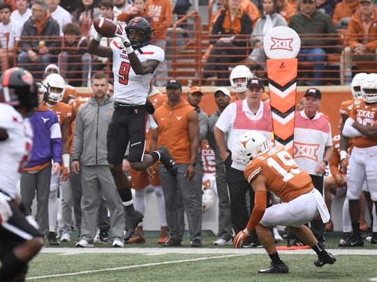 Nov 29, 2019; Austin, TX, USA; Texas Tech Red Raiders wide receiver T.J. Vasher (9) leaps to catch a pass in the first half of the game against the Texas Longhorns at Darrell K Royal-Texas Memorial Stadium. Mandatory Credit: Scott Wachter-USA TODAY Sports