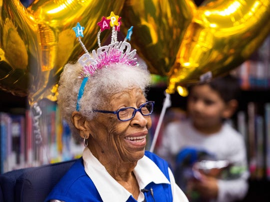 "Conster ""Granny"" Davis smiles during her 100th birthday party thrown by Galvan Elementary School in Corpus Christi, Texas. ""It makes me happy,"" Davis said of volunteering at Galvan. ""It gives you something to wake up to and look forward to."""