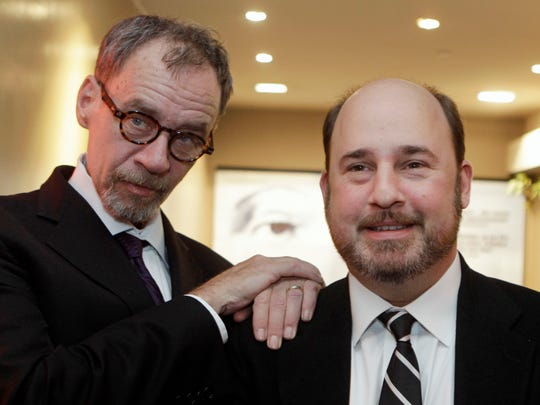 "FILE - In this Nov. 21, 2011, file photo, New York Times journalist David Carr, left, and director Andrew Rossi, right, pose for photographs as they arrive for the French premiere of the documentary ""Page One: A Year Inside The New York Times,"" in Paris. Carr collapsed at the office and died in a hospital Thursday, Feb. 12, 2015. He was 58. Carr wrote the Media Equation column for the Times, focusing on issues of media in relation to business and culture. (AP Photo/Michel Euler, File)"