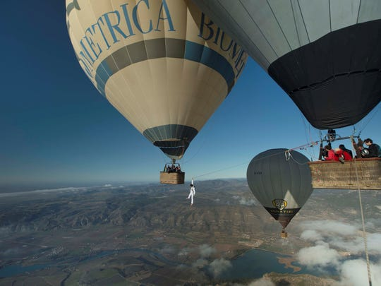 """The film """"Balloon Highline"""" is one of 10 films that will be shown at the Telluride Moutianfilm on Tour. The movie showcases slacklining between hot air balloons."""