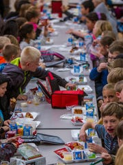 Student at East Elementary in Cedar City eat lunch, Tuesday, Nov. 17, 2015.
