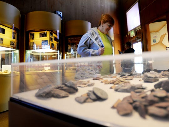 Mary Beth Morris looks at some artifacts at the museum at Poverty Point State Historic Site.