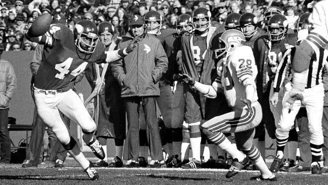 Chuck Foreman carries the ball against the Seattle Seahawks during the 1976 regular season at the old Met Stadium in Bloomington. The Vikings play host to the Seahawks in the NFC Wild Card round Sunday at TCF Bank Stadium, marking the first outdoor playoff game the team has hosted since Foreman and company beat the Los Angeles Rams in the 1976 NFC Championship Game.