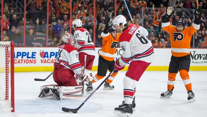 Matt Read, right, had another goal Saturday. He leads the Flyers with five.