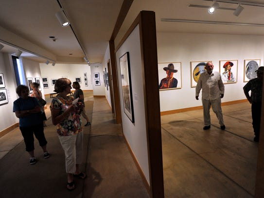 Museum patrons view exhibits by Watt Casey, Jr. and
