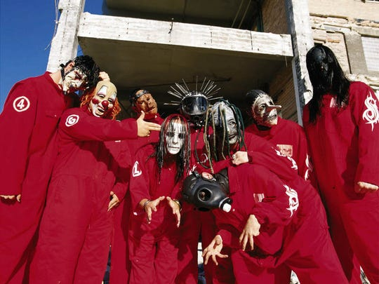 In 2000, when this photo was taken, as now, members of Slipknot wear masks to secure their anonymity and to focus on the band as a gruesome whole. Paul Gray is third from left, in pig mask.