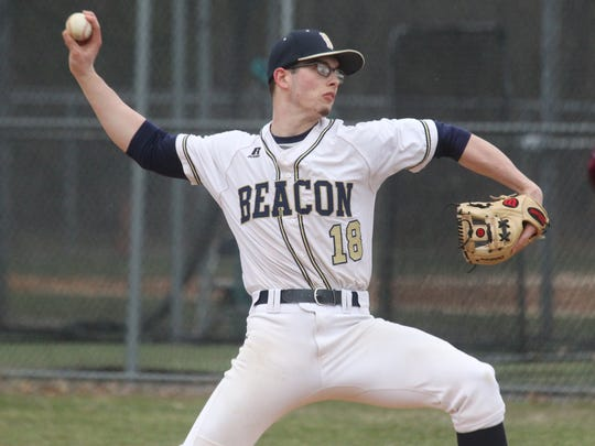 Beacon's Alex Callaway delivers a pitch during during a game at Arlington April 7, 2017.