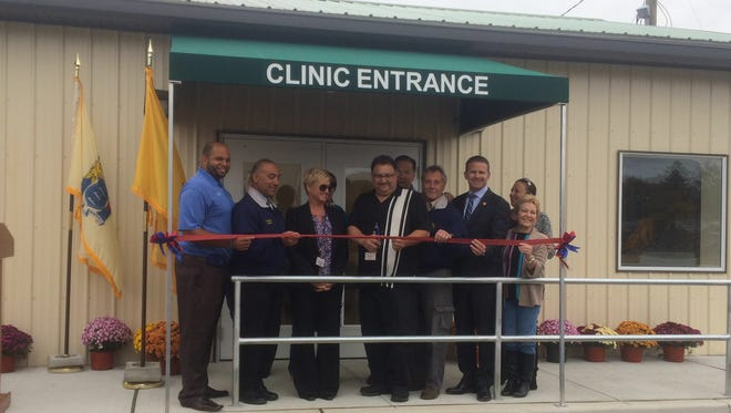 Gloucester County Animal Shelter Director Bill Lombardi cuts the ribbon on a spay/neuter clinic that will be run by People for Animals.